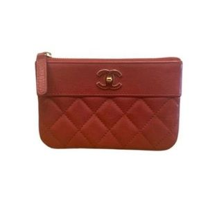 Chanel O pouch. Caviar red. Comes with box and proof of authenticity.